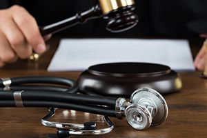 Picture of a stethoscope on a judge's desk