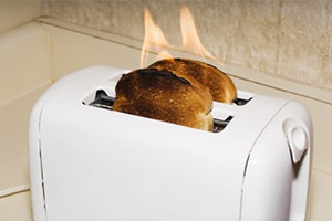 Picture of a toaster on fire demonstrating product liability
